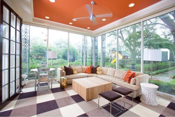 Оранжевый натяжной потолок на веранде