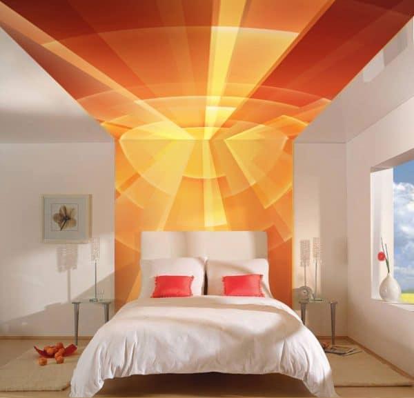 оранжевый натяжной потолок в спальне